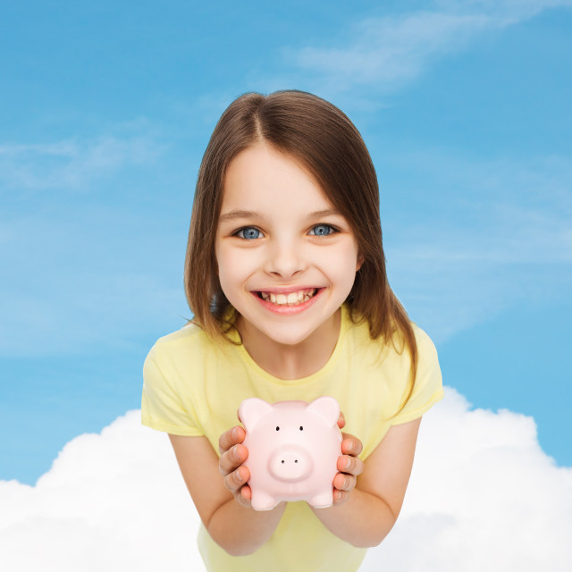 """""""beautiful little girl with piggy bank"""" stock image"""