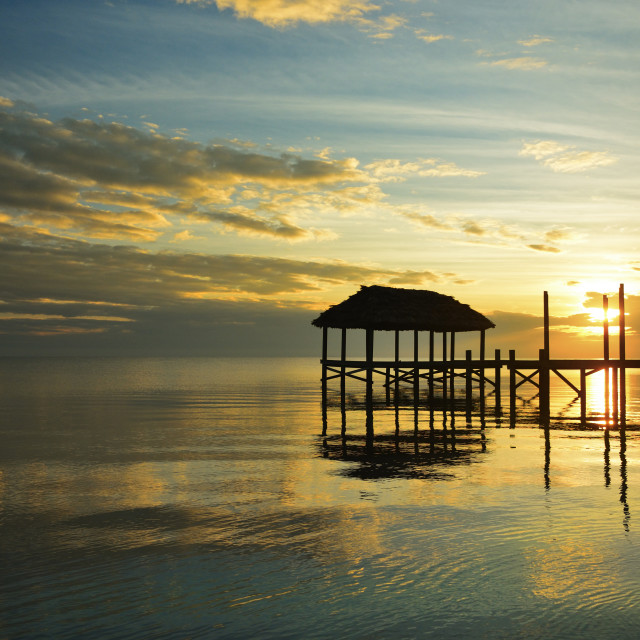 """Pier at sunrise"" stock image"