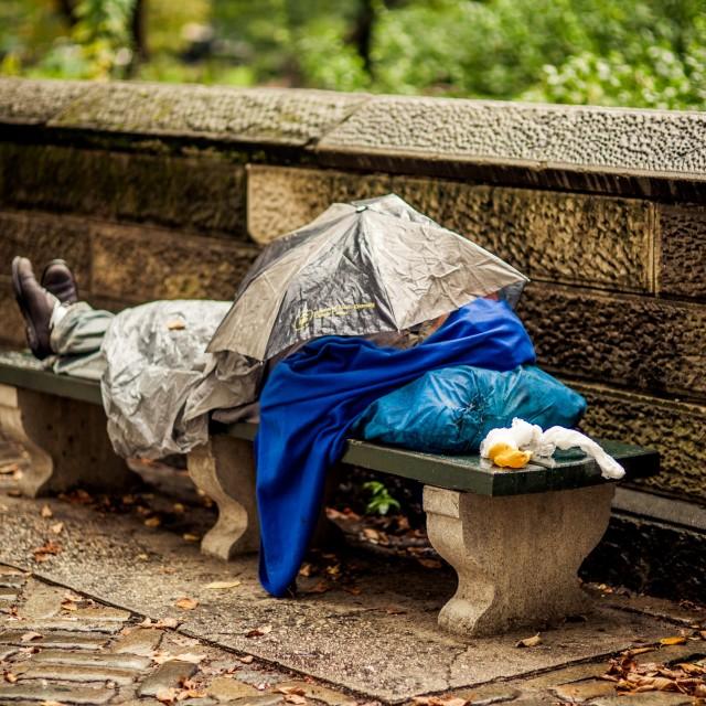 """homeless sleeping on a bench"" stock image"