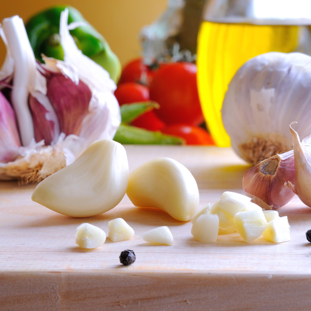 """""""Prepared white garlic on a cutting table"""" stock image"""