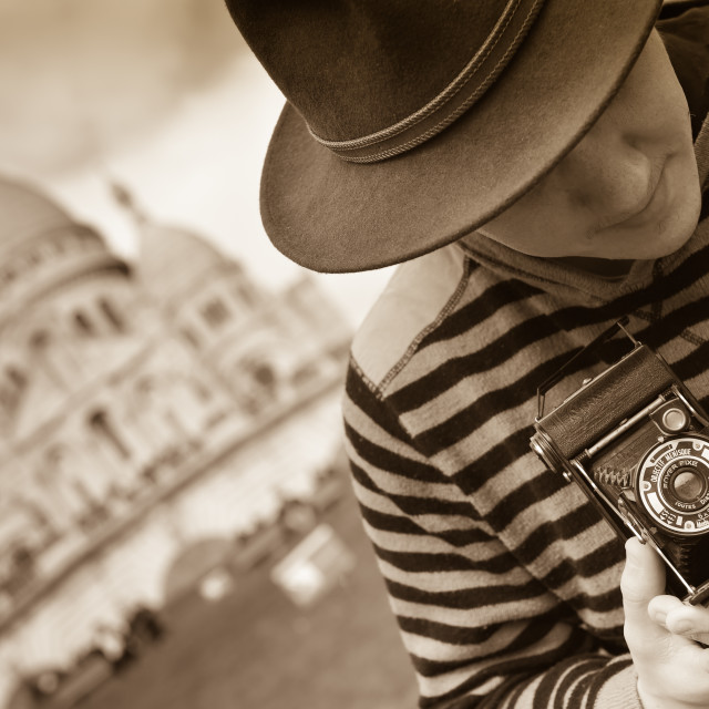 """""""France, Paris, young man taking photograph, Sacre Coeur in backg"""" stock image"""