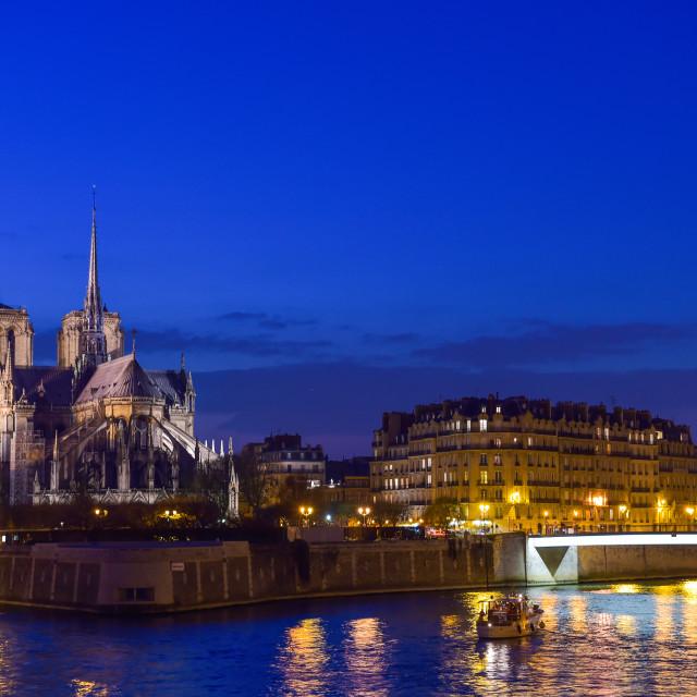 """""""France, Paris, Illuminated Notre Dame de Paris seen from Seine a"""" stock image"""