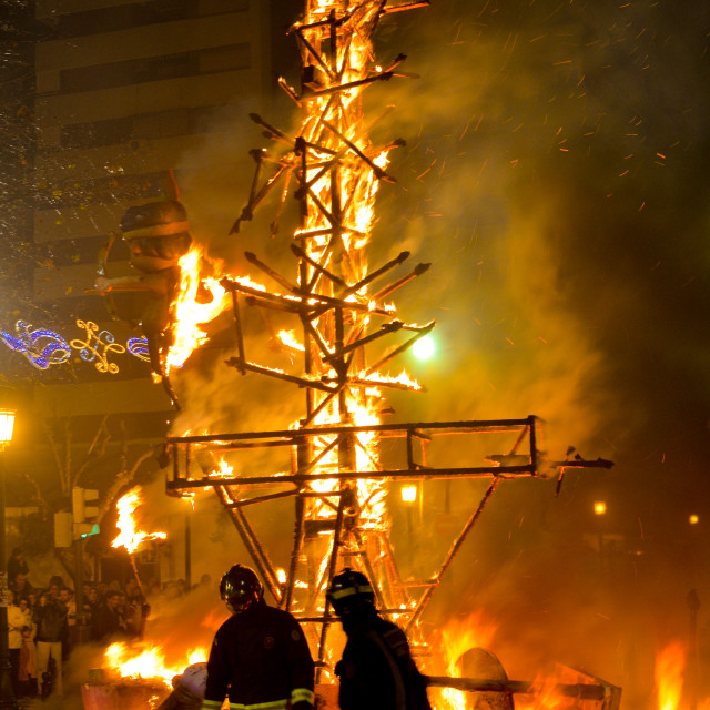 """Firemen walking away from a burning sculpture, Las Fallas festival"" stock image"