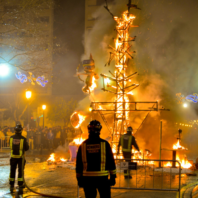 """Firemen watching a burning sculpture during Las Fallas festival"" stock image"