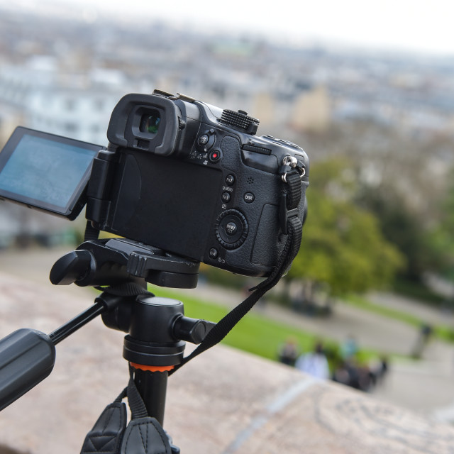 """Digital camera on tripod"" stock image"