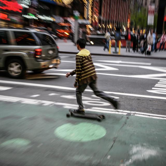 """Skateboarder in Manhattan"" stock image"