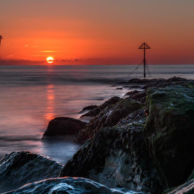 """""""Sunrise at Walton on Naze"""" stock image"""