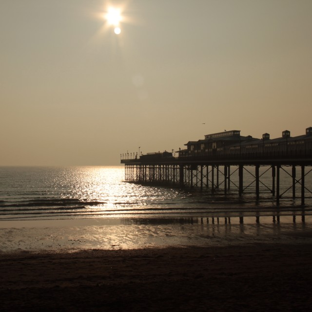 """Paignton. Sunrise over pier"" stock image"