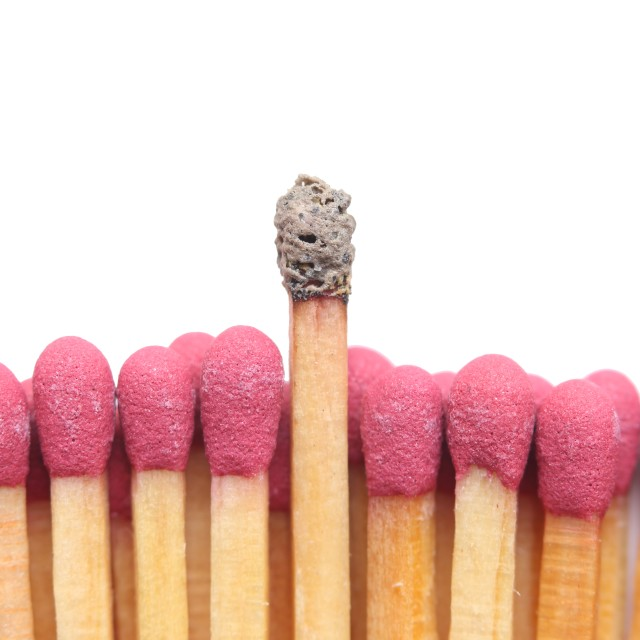 """Row of matches with one standing out"" stock image"
