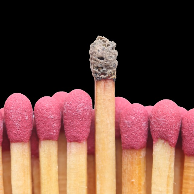 """""""Row of matches with one standing out"""" stock image"""