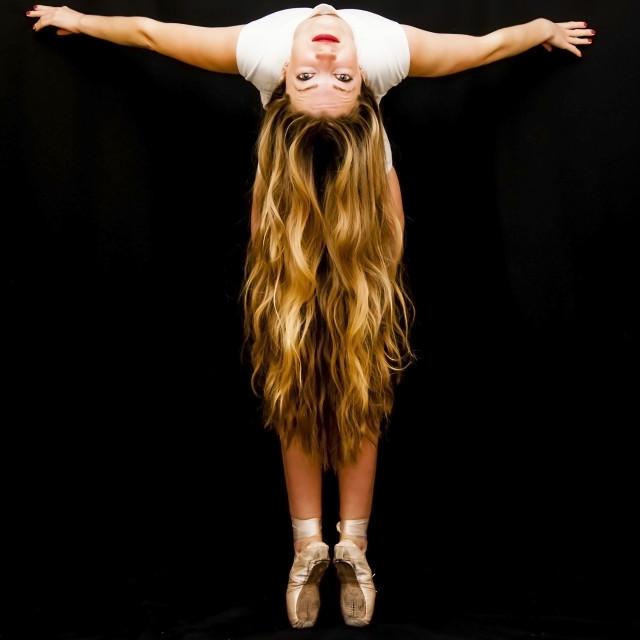 """Ballet dancer performing dance exercises"" stock image"