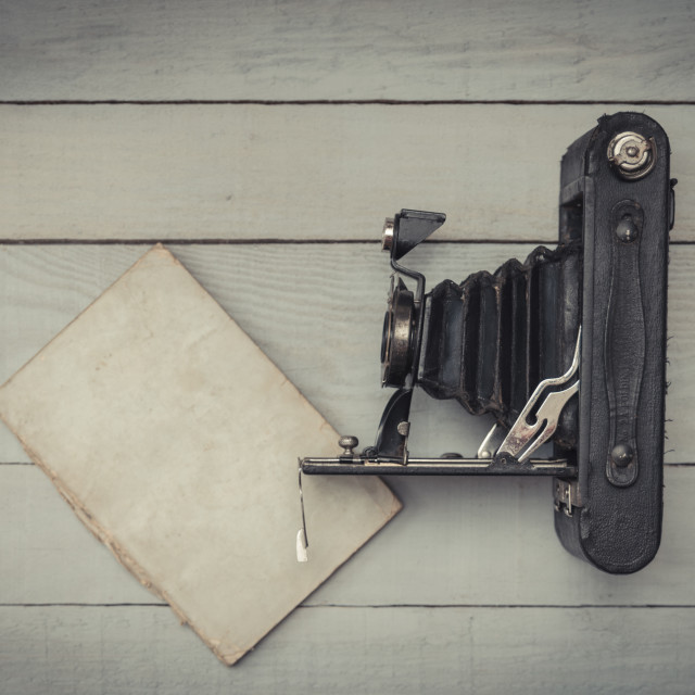 """Antique photography camera and notebook on wooden background"" stock image"