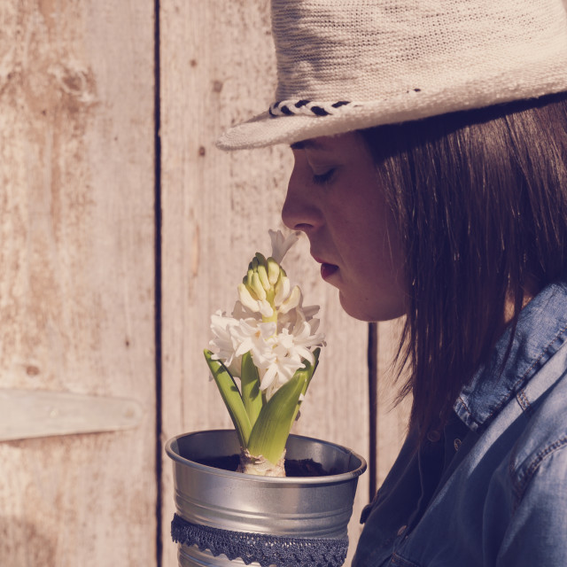 """Woman holding in hands a white hyacinth flower"" stock image"