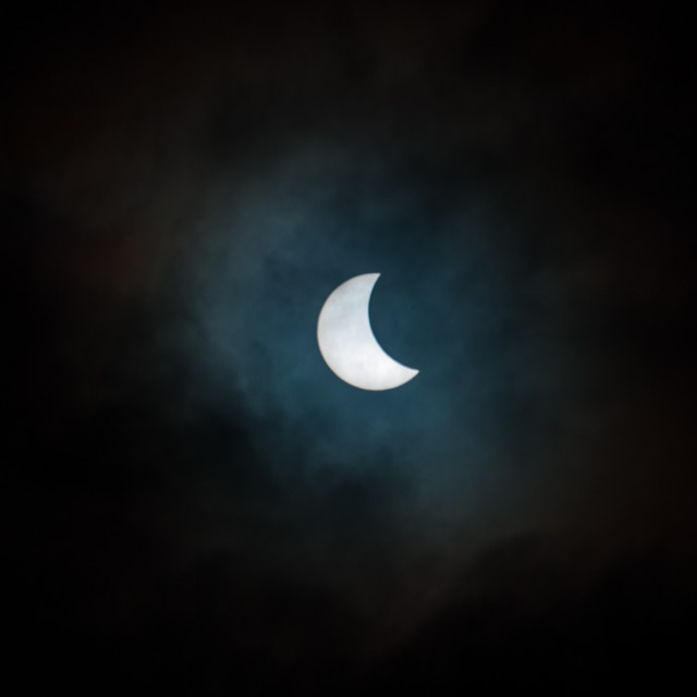 """""""Solar Eclipse Through Clouds"""" stock image"""