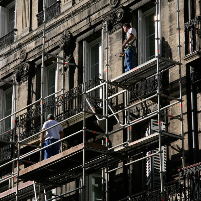 """Men on Scaffolding"" stock image"