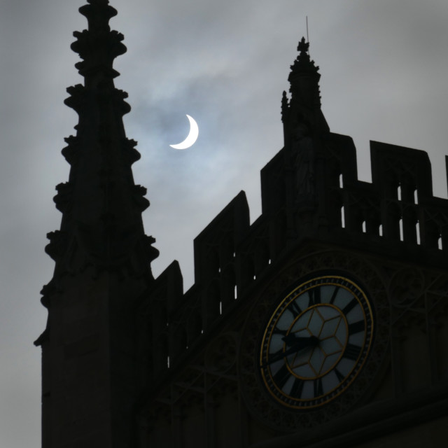 """Partial Solar Eclipse, Bath Abbey roofline March 2015"" stock image"