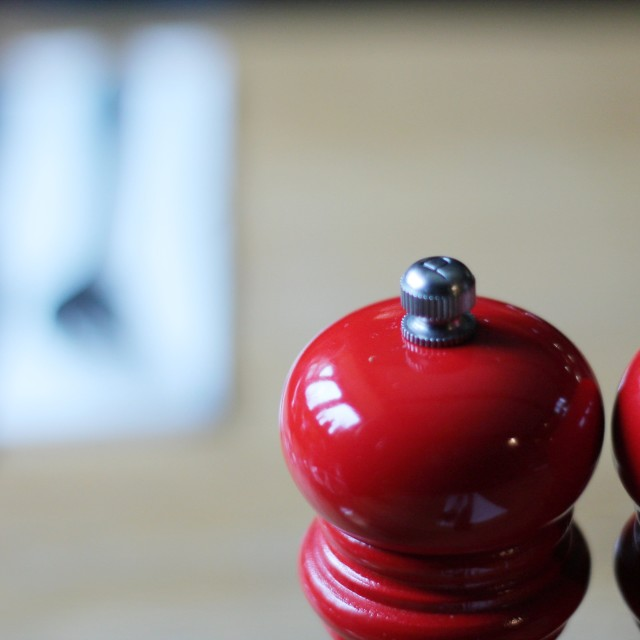 """""""Detail shot of red salt and pepper grinders"""" stock image"""
