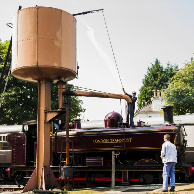 """Steam Locomotive Taking on Water"" stock image"