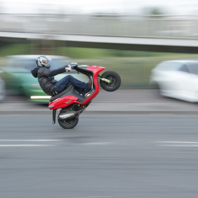 """Scooter Wheelie"" stock image"