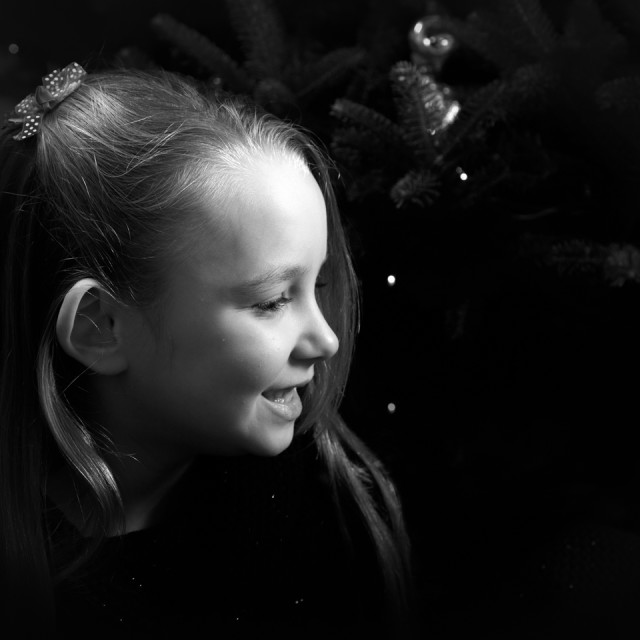 """Young Girl in front of Christmas Tree"" stock image"
