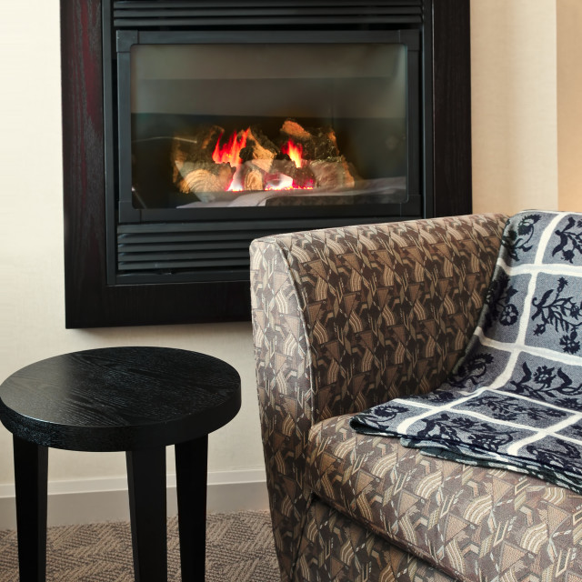 """Fireplace and armchair"" stock image"