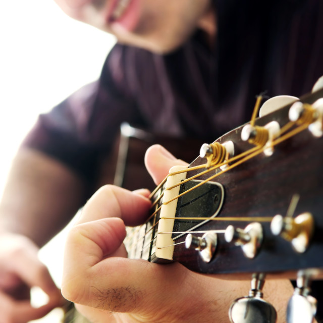 """Man playing a guitar"" stock image"