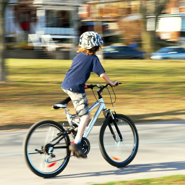 """""""Boy riding a bike"""" stock image"""