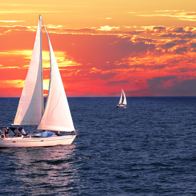 """Sailboats at sunset"" stock image"