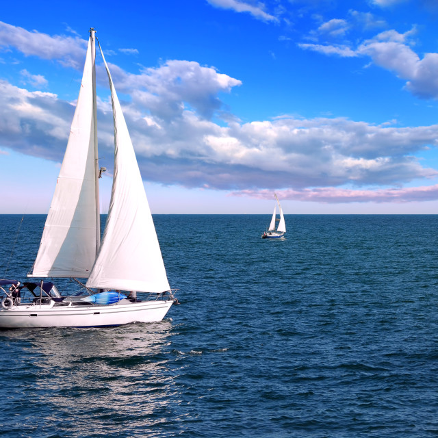 """Sailboats at sea"" stock image"