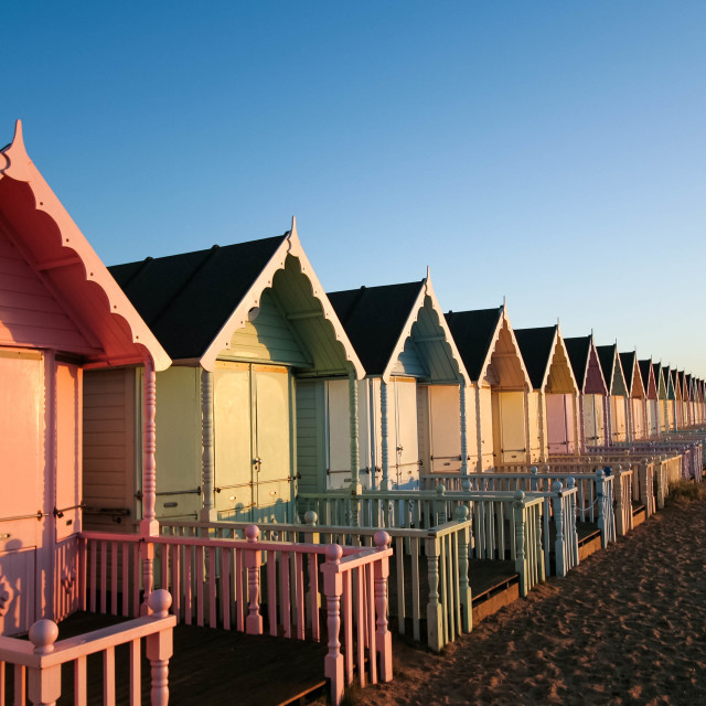 """Mersea Beachhuts at sunrise"" stock image"
