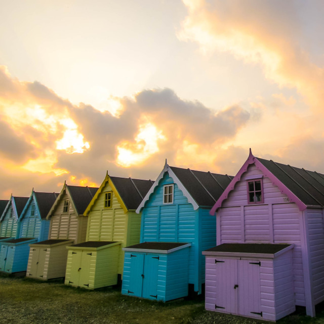 """Beachhuts facing the sunrise"" stock image"
