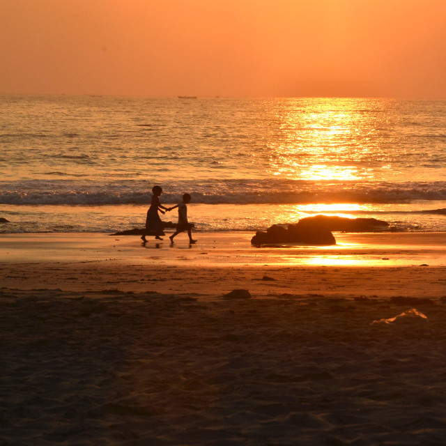 """""""children on a beach at sunset"""" stock image"""