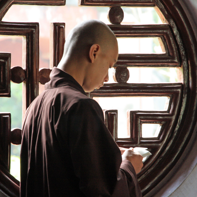 """Vietnamese monk reading his prayers"" stock image"