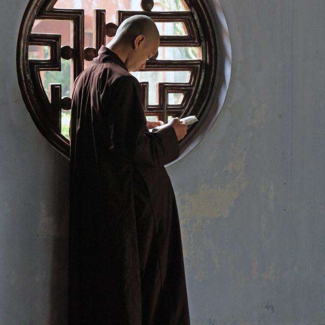 """Vietnamese monk studying"" stock image"