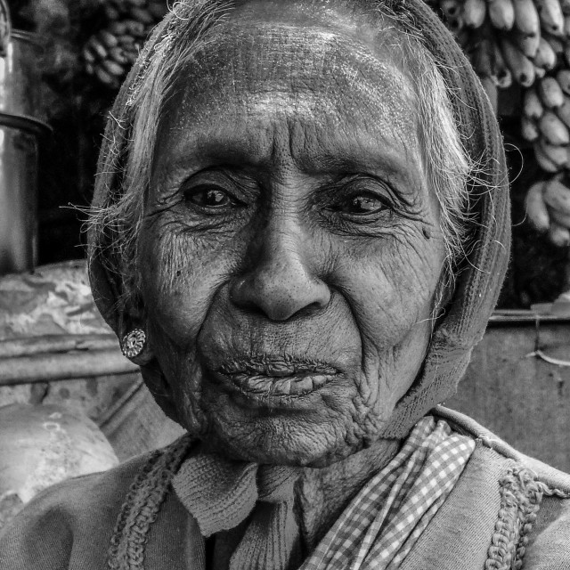 """Old lady at tea stall"" stock image"