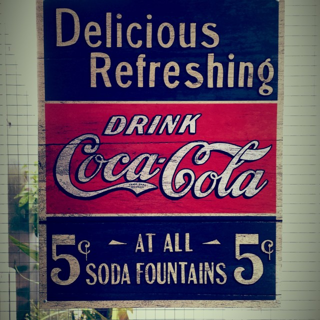 """Old fashioned Coca Cola poster"" stock image"