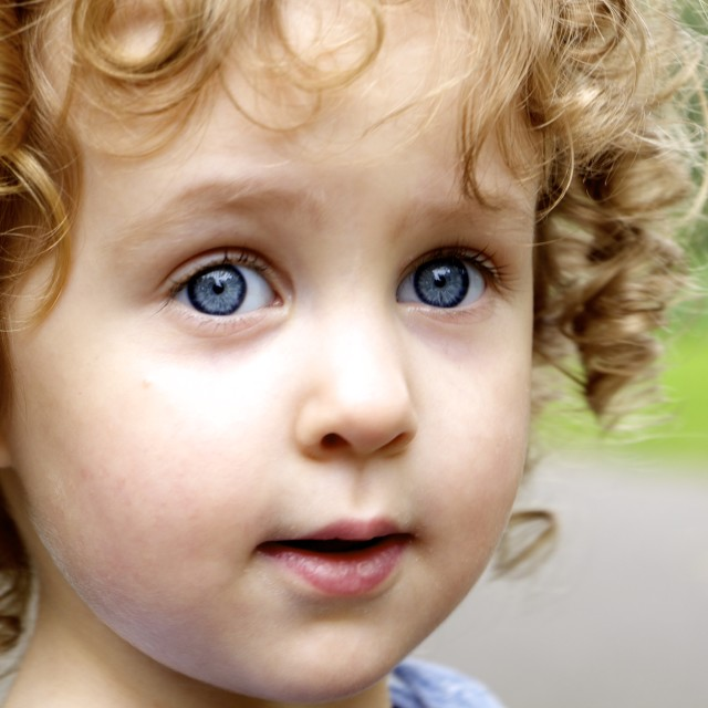 """blue eyed & curly haired"" stock image"