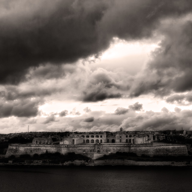 """Fort Manoel enshrouded in storm clouds"" stock image"