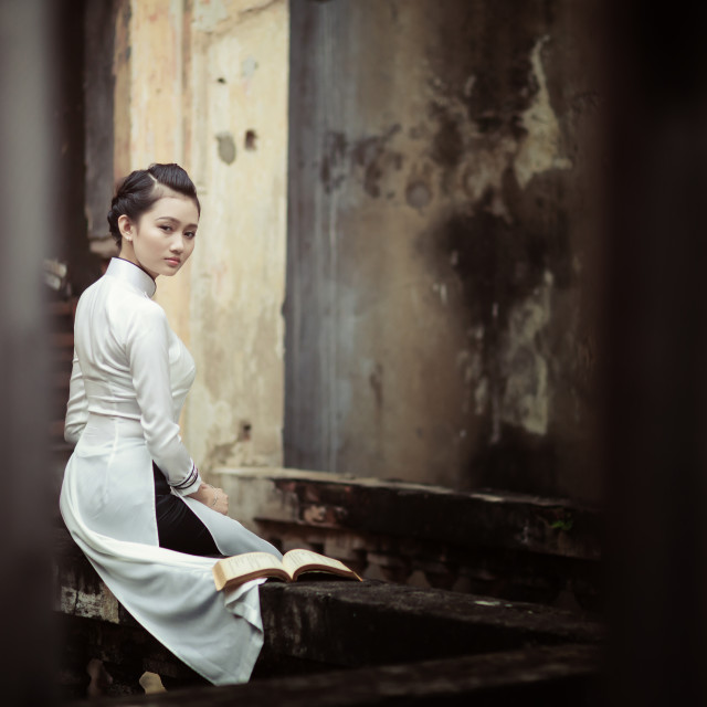 """""""Vietnamese young women with Ao Dai in old town"""" stock image"""