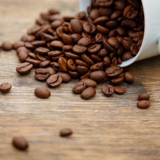 """""""Coffee cup filled with coffee beans"""" stock image"""