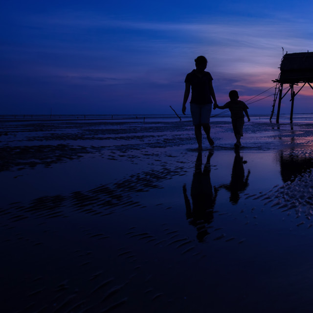 """""""mother and son playing on the beach in dawn time"""" stock image"""