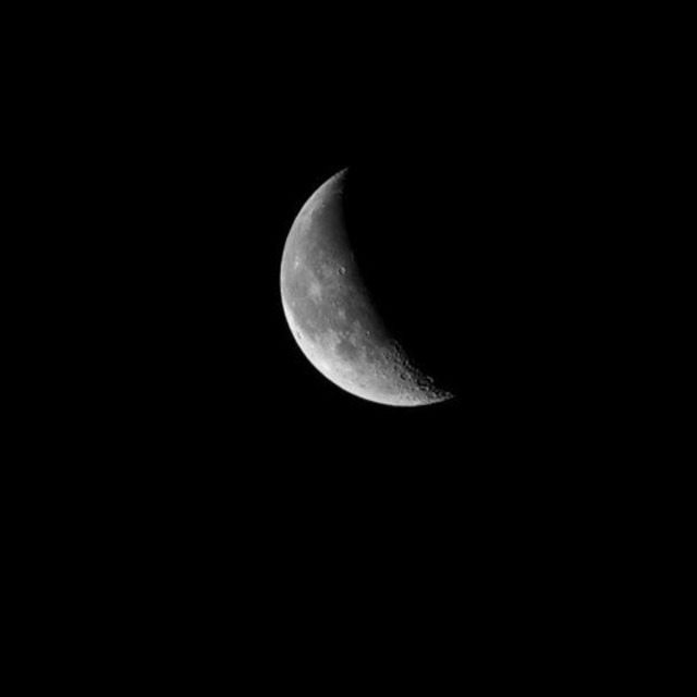 """Waning Crescent Moon"" stock image"
