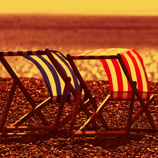 """Empty Deckchairs on Beach"" stock image"