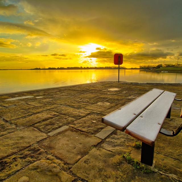 """Frosty bench at sunrise"" stock image"