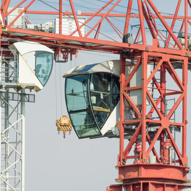 """Two Tower Cranes Operator Cabins Facing"" stock image"
