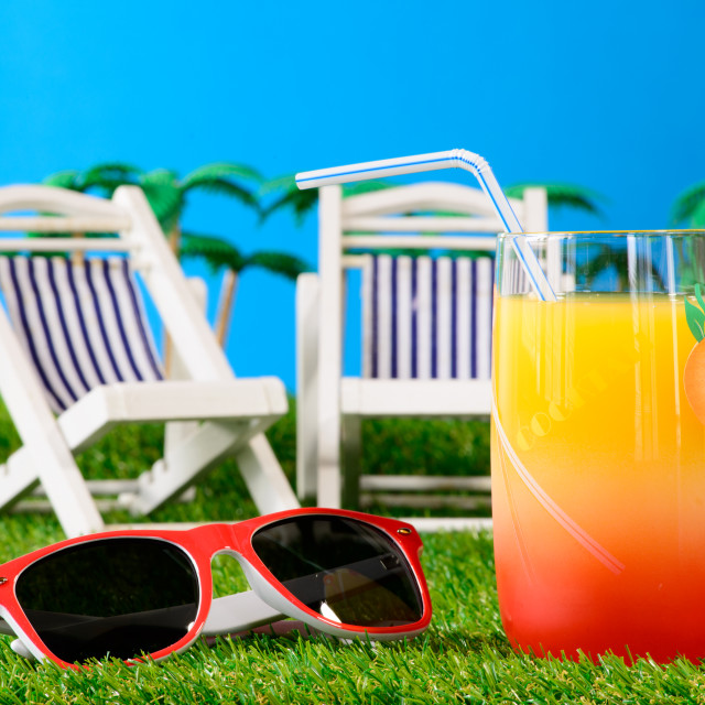 """""""orange juice cocktail on the grass with sunglasses"""" stock image"""