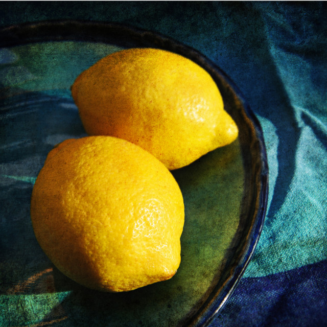 """Lemons on a blue plate"" stock image"
