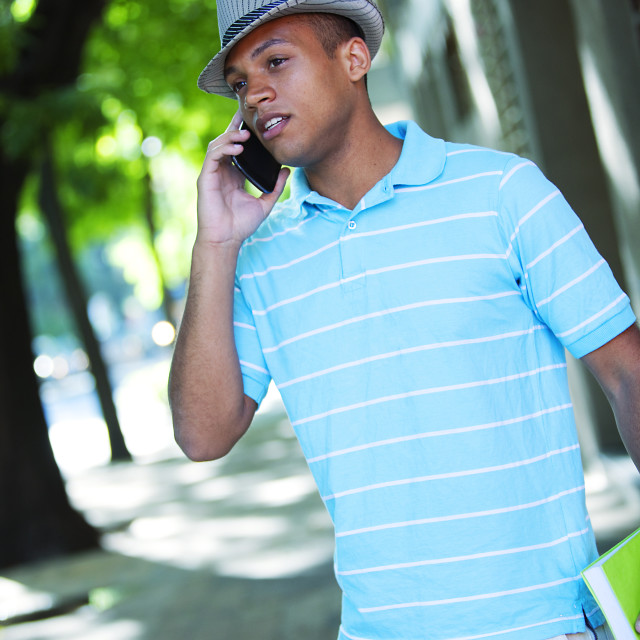 """Happy african american young man on the phone"" stock image"