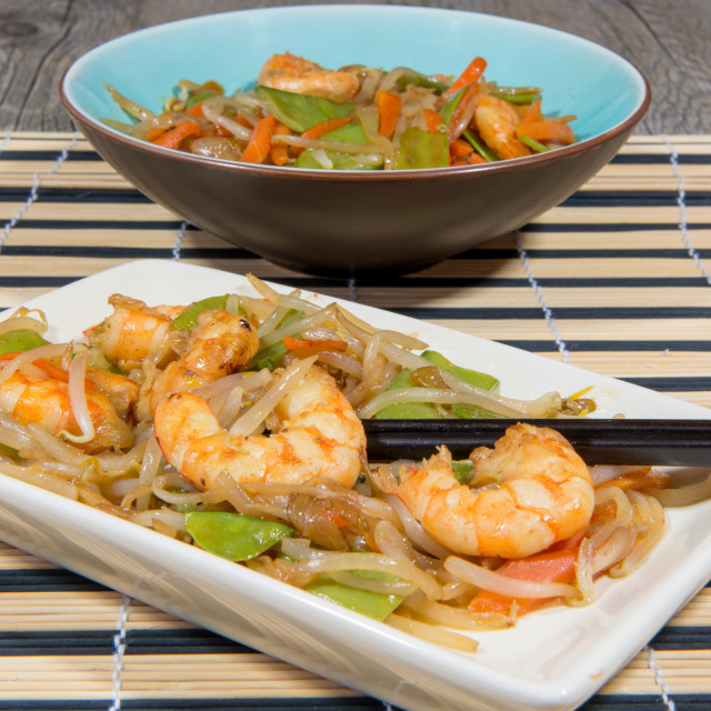 """dish of prawns and cooked vegetables in a wok"" stock image"