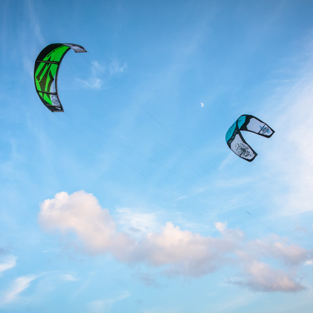 """Kites against a cloudy blue sky"" stock image"